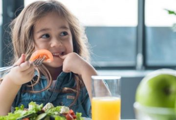 little girl eating salad 1410x614