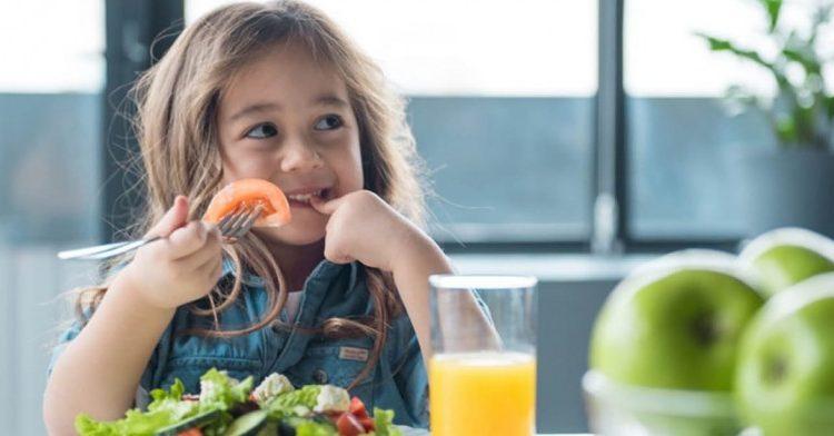 little girl eating salad 1410x614